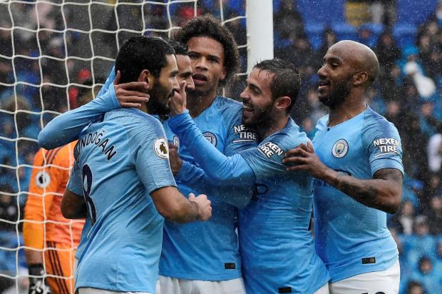 Manchester City players celebrate their victory against Cardiff City.