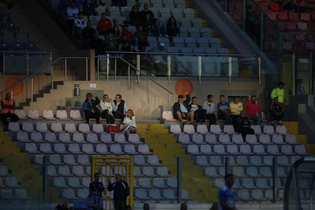 Supporters watch the FA Trophy quarter-final soccer match between Pembroke Athleta and Pieta Hotspurs at the National Stadium in Ta'Qali on April 20. Photo: Darrin Zammit Lupi