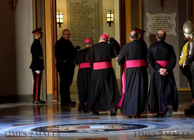 The Archbishop of Malta Charles Scicluna, and other members of the clergy escort themselves out of the President's Palace in Valletta after the festive greetings on December 27. Photo: Mark Zammit Cordina