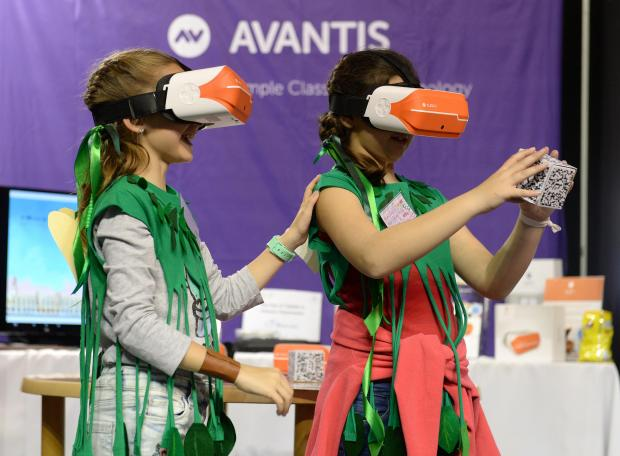 Two girls wear VR headsets at the Malta Robotics Olympiad at the MFCC grounds in Ta'Qali on April 20. Photo: Matthew Mirabelli