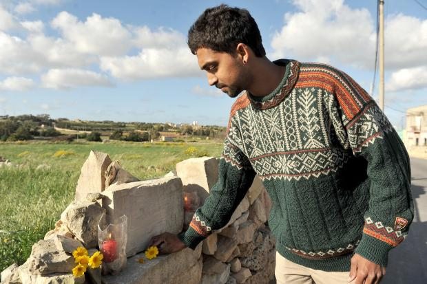 Yunus Berndt lays flowers at the site where Photo: Chris Sant Fournier