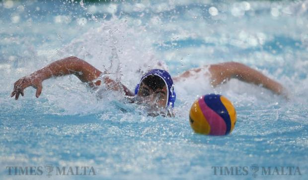 Malta's Matteo Cacici races for the ball during the European U-19 Championship Group A qualifying waterpolo match against Slovenia at the National Pool in Tal-Qroqq on May 7. Photo: Darrin Zammit Lupi
