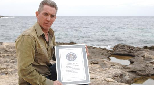 Sean McGahern with his Guinness World Record certificate for the longest open seawater dive. Photo: Matthew Mirabelli.