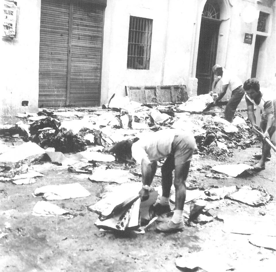 Workers clearing up the debris after the Times of Malta building in St Paul Street, Valletta was ransacked and burned to the ground in October 1979.