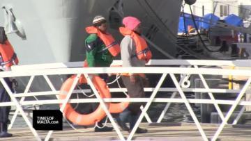 Watch: Stranded for 11 days, migrants finally reach land | The migrants landing in Malta. Video: Mark Zammit Cordina