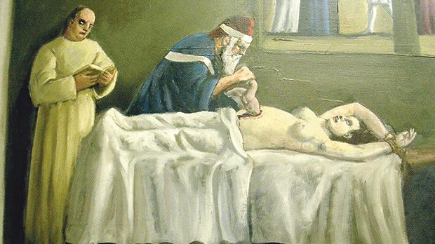 An antique image of a surgeonperforming a Caesarean section.