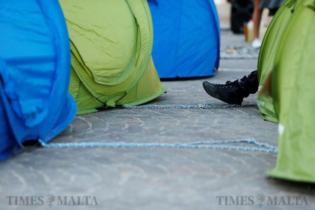 Chains used to tie tents to each other are seen in a camp set up by environmental activists protesting against what they say is over-development throughout the Maltese islands, in front of the Auberge de Castille housing the Office of the Prime Minister in Valletta on May 14. Photo: Darrin Zammit Lupi
