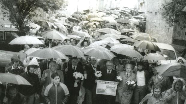 Then Nationalist leader Eddie Fenech Adami and deputy Guido de Marco leads thousands in silent protest over the shooting.