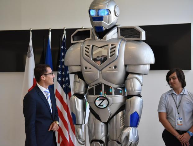Parliamentary Secretary Silvio Schembri talks to a robot at the Esplora Science Center in Kalkara on July 10. Photo: Mark Zammit Cordina