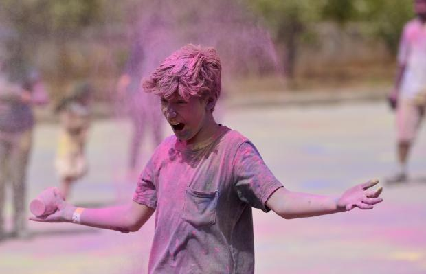 A boy drops pink coloured powder paint on himself during the Holi Festival organized by the Indian Community held in St Venera on April 06. Photo: Mark Zammit Cordina