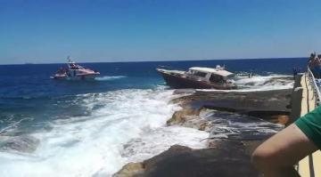 Watch: Cabin cruiser runs aground off Sliema coast