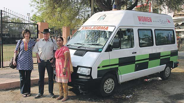 Leah Pattison, Chev Paul Warren and Usha Patil stand next to an ambulance donated by the Military and Hospitaller Order of Saint Lazarus of Jerusalem in 2010.