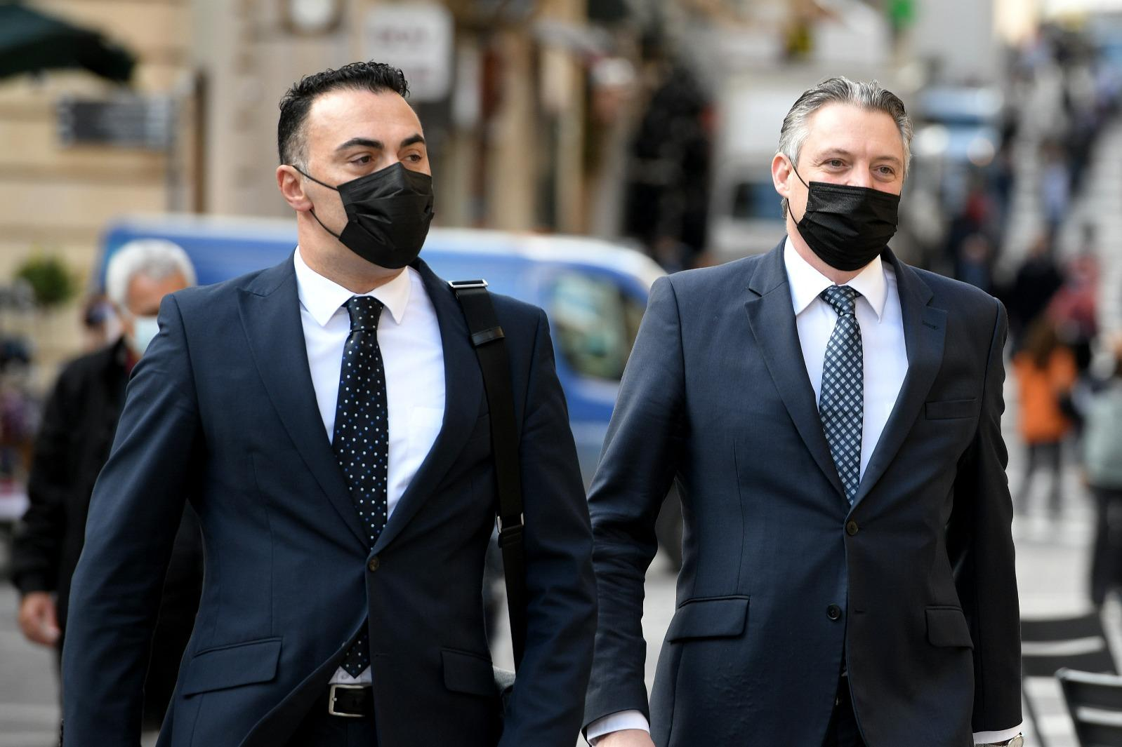 Konrad Mizzi, right, arrives at the inquiry on Friday. Photo: Matthew Mirabelli