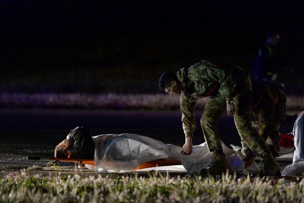 A man lies on the runway after being evacuated off an airplane during a full-scale emergency exercise at the Malta International Airport on March 27, to test the preparedness of key stakeholders that would be mobilsed in the event of a real-life accident at the airport. Photo: Matthew Mirabelli