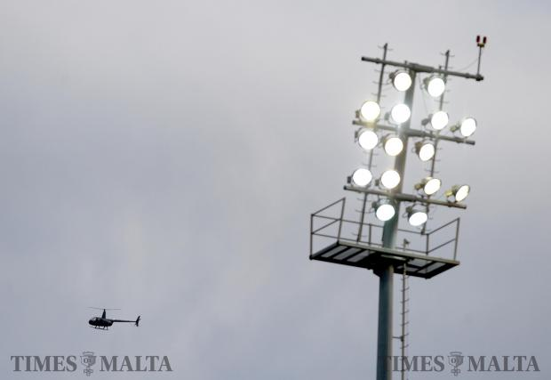 A helicopter flies over the Hibernians football Stadium in Paola on January 20. Photo: Matthew Mirabelli
