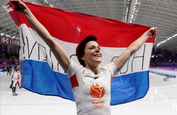 Ters Mors celebrates her victory in the women's 1,000m race.