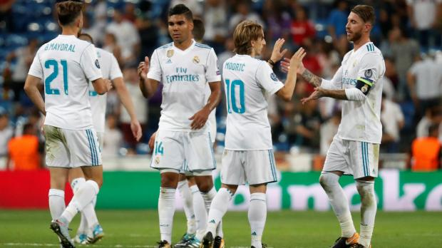 Real Madrid's Sergio Ramos (R), Luka Modric (2nd R) and Casemiro celebrate after the match.