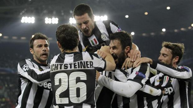 Juventus' Fabio Quagliarella (C, hidden) is surrounded by his teammates after scoring against Chelsea