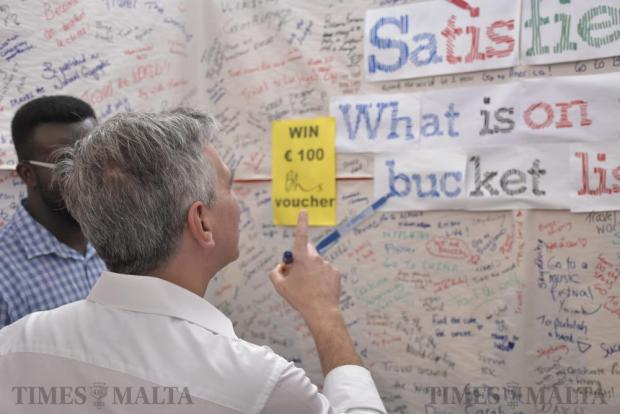 Opposition Leader Simon Busuttil writes down his bucket list on a board during Freshers Week at the University of Malta in Tal-Qroqq on October 4. Photo: Mark Zammit Cordina