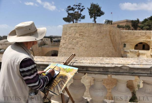 The recently restored Valletta bastions catch the eye of an artist, capturing their grandeur with bright colours on his canvas on April 25. Photo: Chris Sant Fournier
