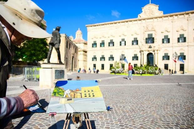 An artist is inspired by Castille Square and the monument to Manwel Dimech on November 20. Originally erected on May 1, 1976, the monument was modelled and cast in bronze by sculptor Anton Agius. Photo: Jonathan Borg