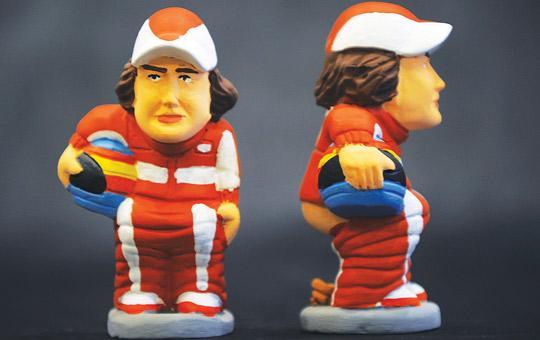 Ceramic figurines, called caganer, of Spongbog Squarepants and Ferrari driver Fernando Alonso. Photos: Lluis Gene/AFP