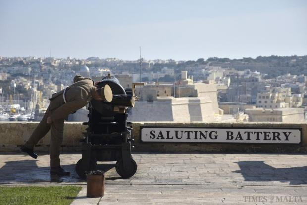 A British Army re-enactor looks through the cannon breech at the Upper Barrakka Gardens in Valletta before a midday gun salute on January 29. Photo Mark Zammit Cordina