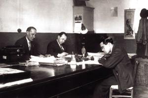 Karmenu Vassallo (right) at his desk as literary editor at Il-Berqa. Also seen are G. Casolani and N. Biancardi (1938-39).