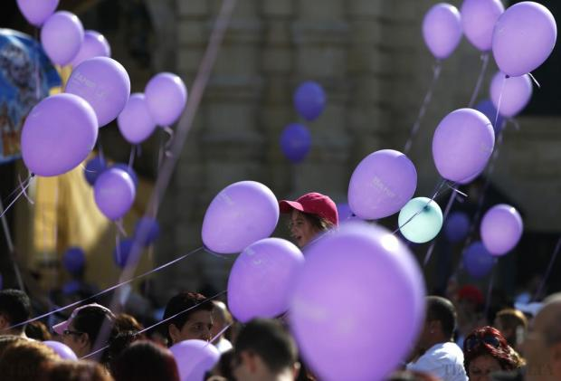 A young participant sits on her father's shoulders, surrounded by balloons, at the end of the President's Solidarity Fun Run 2015 at St George's Square in Valletta on November 15. Photo: Darrin Zammit Lupi