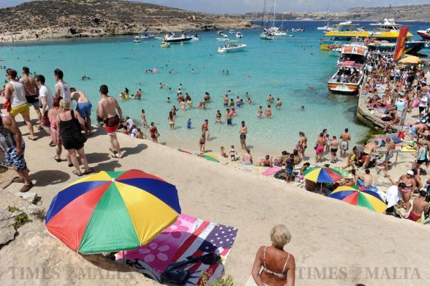 Bathers enjoy the summer sun and clear waters at Blue Lagoon, Comino on August 17. MTA officials descended on Comino to bring order to the chaotic situation in which beach operators crowd the tiny beach at the Blue Lagoon with deckchairs and umbrellas. Photo: Steve Zammit Lupi