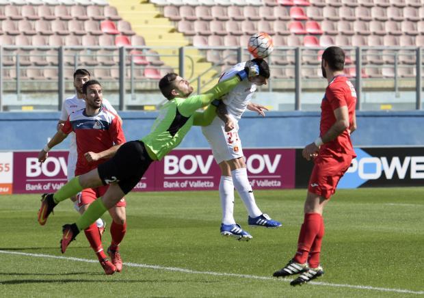 Pembroke goalkeeper Matthew Calleja Cremona is anticipated by Maximiliano Velasco, the Valletta striker. in a match held at Ta Qali Stadium on March 11. Photo: Mark Zammit Cordina
