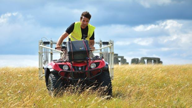 A man driving an all terrain vehicle with surveying instruments near to Stonehenge. Photos: Geert Verhoeven/University of Birmingham/PA Wire