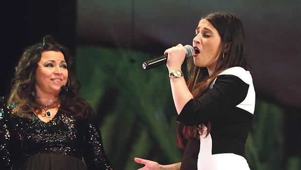 Maltese singer Amber (right) joined Alotta during the concert to sing Un Anno di Noi as a duet.