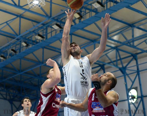 Hibernians take a shot at the basket during the second leg of the Louis Borg cup against Gzira Athleta at the Basketball Pavilion in Ta'Qali on December 13. Photo: Matthew Mirabelli