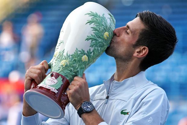 Novak Djokovic kisses the trophy in Cincinnati on Sunday night.