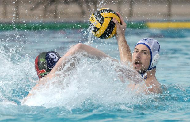 Malta's Steve Camilleri looks for space whilst being marked by Belarus's Andrei Shalamitski during their European Water Polo Championship play-off match at the National Pool in Tal Qroqq on March 3. Photo: Matthew Mirabelli