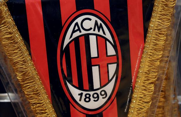 The Milan logo is pictured on a pennant in a soccer store in downtown Milan.