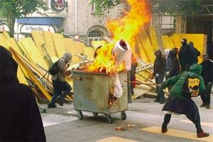 Anti-G8 demonstrators block a street with a burning container in downtown Lausanne during a protest march in the Swiss city across Lake Geneva from Evian, site of the G8 summit yesterday.