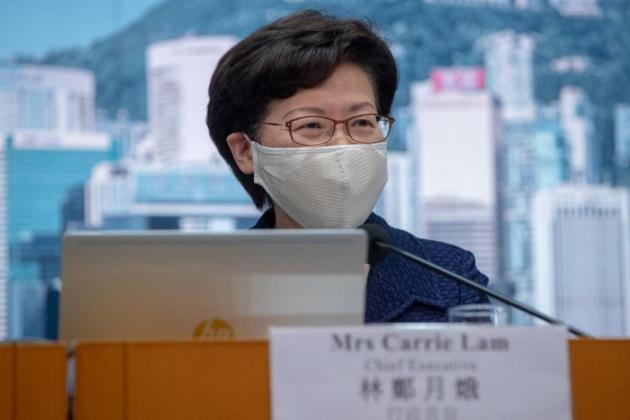 Hong Kong postpones elections over virus as China crackdown deepens