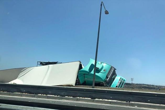 Cargo trailer flips on its side in Marsa