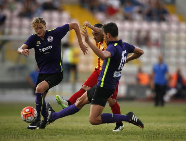 Birkirkara's Fabrizio Miccoli (centre) scores his side's opening goal as St Andrew's Nicola Andreis (left) and Michael Johnson (right) try to block him during their Premier League football match at the National Stadium in Ta'Qali on October 4. Photo: Darrin Zammit Lupi