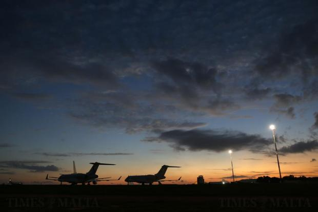 Aircraft sit on the apron at Malta International Airport at sunset on November 23. Photo: Darrin Zammit Lupi