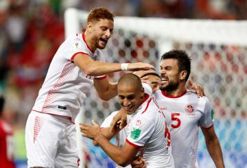 Tunisia's Wahbi Khazri celebrates scoring their second goal with team mates.