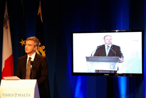 Opposition leader Simon Busuttil pauses his press conference to watch and comment on a video clip of Prime Minister Joseph Muscat, at party headquarters in Pieta on December 6. Photo: Mark Zammit Cordina