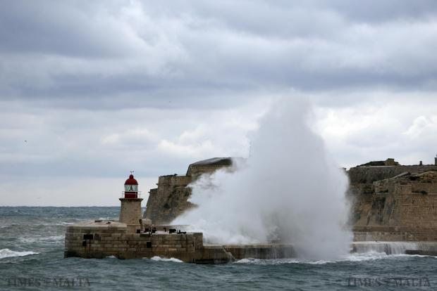 Waves crash against the breakwater of Valletta's Grand Harbour on January 1. Photo: Darrin Zammit Lupi