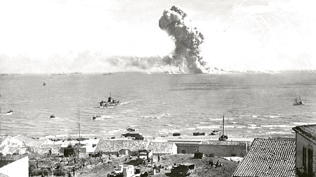 Liberty ship SS Rowan explodes after being hit by a German bomb, near Gela, Sicily on July 11, 1943.