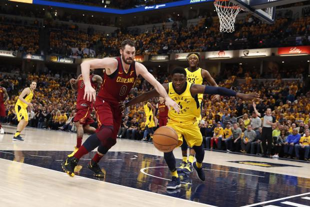 Cleveland Cavaliers forward Kevin Love (0) scrambles for a loose ball against Indiana Pacers guard Victor Oladipo (4) during the third quarter in game three of the first round of the 2018 NBA Playoffs at Bankers Life Fieldhouse. Photo Credit: Brian Spurlock-USA TODAY Sports