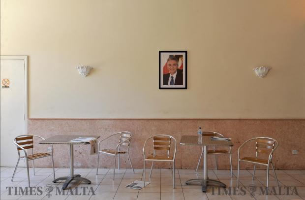 A portrait of outgoing PN leader Simon Busuttil hangs from the wall of the PN club in Zebbug on June 15. Photo: Chris Sant Fournier