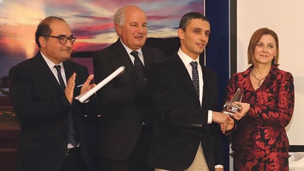 Manuel Sultana receiving the Worker of the Year Award from Gozo Minister Justyne Caruana in the presence of Paul Pisani and Paul Scicluna. Photos: Charles Spiteri