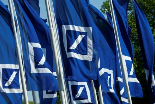 Flags with the logo of Deutsche Bank are seen at the headquarters ahead of the bank's annual general meeting in Frankfurt, Germany.